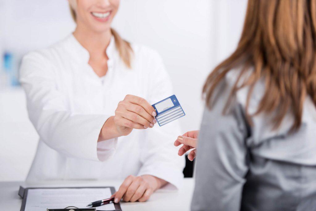 Patient providing insurance information